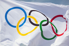 Olympic flag. THESSALONIKI, GREECE - MAY 13: At the event of arrival of the Olympic flame in Thessaloniki the flag of the Olympic Games flew into the blue sky on royalty free stock photography