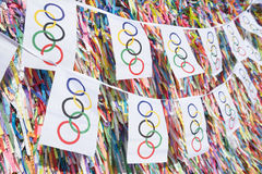 Olympic Flag Bunting Hanging in front of Brazilian Wish Ribbons Stock Photos