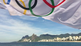 Olympic Flag Fluttering Rio de Janeiro Brazil. RIO DE JANEIRO, BRAZIL - FEBRUARY 12, 2015: An Olympic flag flutters in slow motion in the wind above the city stock footage