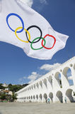 Olympic Flag Flying at Arcos da Lapa Arches Rio de Janeiro. RIO DE JANEIRO, BRAZIL - MARCH 6, 2015: Olympic flag flies in the plaza above the famous Lapa Arches royalty free stock image