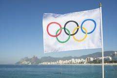 Olympic Flag Flying Rio de Janeiro Brazil. RIO DE JANEIRO, BRAZIL - FEBRUARY 12, 2015: An Olympic flag flies above the city skyline at Ipanema Beach with a view stock photos