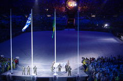The Olympic flag leaves the stadium. The Brazilian military force troop the Olympic flag in a light rain inside the Maracana Stadium during Rio2016 closing stock photo