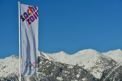 Olympic flag over the snowy mountains Royalty Free Stock Images