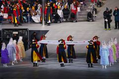 The Olympic flag raising ceremony at PyeongChang Olympic Stadium during the 2018 Winter Olympics Opening Ceremony Royalty Free Stock Photo