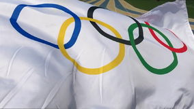 Olympic Flag Waving at Running Track stock video footage
