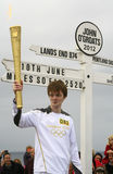 Olympic Flame at John O'Groats sign, Scotland Royalty Free Stock Photo