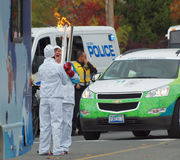 Olympic flame transfer. Olympic flame being transfered between torch bearers on the first day of torch relay in Victoria BC Canada Stock Image