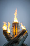 Olympic flame in Vancouver. Vancouver, Canada - February 23, 2014: The Olympic cauldron's flame is lit at Vancouver's Jack Poole Plaza. The flame has been re-lit Stock Photos