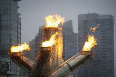 Olympic flame in Vancouver. Vancouver, Canada - February 23, 2014: The Olympic cauldron's flame is lit at Vancouver's Jack Poole Plaza. The flame has been re-lit Royalty Free Stock Photo