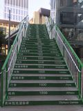 Olympic Footbridge in Causeway Bay, Hong Kong. Each steps has both Chinese and English name of cities which hold the olympic games with the correpsonding Stock Photography