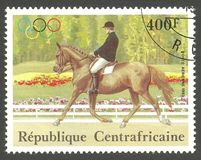 Olympic Games, Dressage of different styles. Central African Republic - stamp printed 1983, Multicolor Air Mail issue, Topic Sport and Horses, Series Olympic Stock Photos