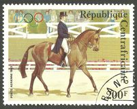 Olympic Games, Dressage at the horse show. Central African Republic - stamp printed 1983, Multicolor Air Mail issue, Topic Sport and Horses, Series Olympic Games Stock Images