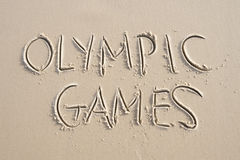 Olympic Games Message Handwritten in Sand Royalty Free Stock Photography
