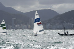 Olympic Games Rio 2016. Rio, Brazil - august 12, 2016: Colin CHENG (SIN) in the Laser Men category during the Rio 2016 Olympic Games Sailing held at Marina da Royalty Free Stock Image