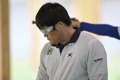 Olympic Games Rio 2016. Rio, Brazil - august 10, 2016: HAN Seungwoo KOR during shooting 50m Pistol Men Shooting at Olympic Games 2016 in Olympic Shooting Centre stock photo