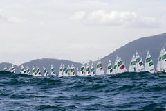 Olympic Games Rio 2016. Rio, Brazil - august 12, 2016: Start in the Laser Women category during the Rio 2016 Olympic Games Sailing held at Marina da Gloria Stock Photos