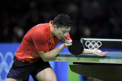 Olympic Games Rio 2016. Rio, Brazil, 11 august 2016: The table tennis player Long MA (CHN) when playing against Jike ZHANG (CHN) during Olympic Games Rio 2016 at Stock Image