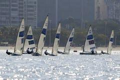 Olympic Games Rio 2016. Rio de Janeiro, Brazil - august 09, 2016: Finn class sailboats in the first regatta at the Gloria marina at the Rio 2016 Olympic Games Royalty Free Stock Photo