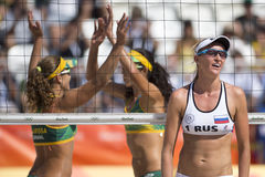 Olympic Games Rio 2016. Rio de Janeiro, Brazil - august 07, 2016: Larissa/Talita BRA and Ukolova RUS during beach volleyball game between Brazil and Russia in Royalty Free Stock Photos