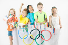 Olympic Games. Rio de Janeiro 2016 Brazil. Group of children holding a flag of five rings symbol of Olympic Games and international flags. Rio de Janeiro 2016 Stock Photography