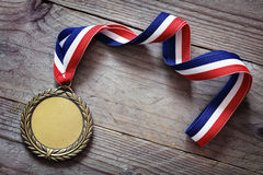 Olympic gold medal. Gold medal on wood background with blank face for text, concept for winning or success Stock Photo