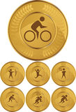 Olympic Gold Medals. Set of seven olympic style gold medals Stock Photos