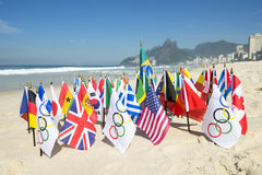 Olympic and International Flags Ipanema Beach Rio. RIO DE JANEIRO, BRAZIL - MARCH 20, 2015: Olympic flags fly together with an array of Brazil and international royalty free stock photo