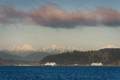 The Olympic Mountains and Ferry Boats Royalty Free Stock Images