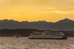The Olympic Mountains and Ferry Boats Stock Photography