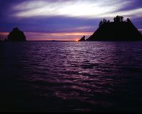 OLYMPIC NATIONAL PARK, OREGON. Sunset on coast with silhouettes of rocky formations Stock Photo