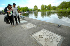 Olympic Park in Munich. MUNICH, GERMANY - MAY 6, 2017 : People sightseeing the celebrity handprints in concrete at the Munich Olympic Walk Of Stars in Olympic Royalty Free Stock Image