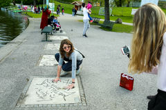 Olympic Park in Munich. MUNICH, GERMANY - MAY 6, 2017 : Tourists taking photos with celebrity handprints in concrete at the Munich Olympic Walk Of Stars in Royalty Free Stock Photo