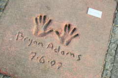 Olympic Park in Munich. MUNICH, GERMANY - MAY 6, 2017 : A view of Bryan Adams handprints and signature in concrete at the Munich Olympic Walk Of Stars in Olympic Royalty Free Stock Image