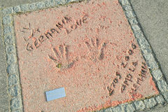 Olympic Park in Munich. MUNICH, GERMANY - MAY 6, 2017 : A view of Eros Ramazzotti handprints and signature in concrete at the Munich Olympic Walk Of Stars in Stock Images