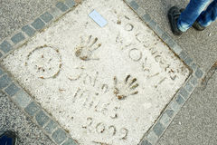 Olympic Park in Munich. MUNICH, GERMANY - MAY 6, 2017 : A view of John Miles handprints and signature in concrete at the Munich Olympic Walk Of Stars in Olympic Stock Photos