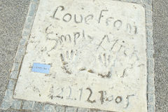 Olympic Park in Munich. MUNICH, GERMANY - MAY 6, 2017 : A view of the Simply Red members handprints and signature in concrete at the Munich Olympic Walk Of Stars Royalty Free Stock Photo