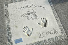 Olympic Park in Munich. MUNICH, GERMANY - MAY 6, 2017 : A view of Udo Lindenberg handprints and signature in concrete at the Munich Olympic Walk Of Stars in Royalty Free Stock Image