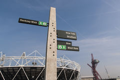 Olympic Park sign post. LONDON, UK – MARCH 24: Details of sign post with Olympic stadium in the background on March 24, 2012 in London. All locations around Stock Photo