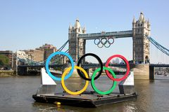 Olympic rings. The olympic rings on the thames, with the rings also suspended from Tower bridge Stock Images