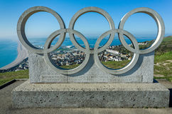 Olympic Rings and Chesil Beach in Dorset, UK Royalty Free Stock Photography