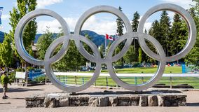 Olympic rings in front of the Canadian flag. Olympic rings in Whistler, Canada is a symbol of Olympic games 2010 Stock Images