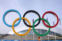 Olympic rings in front of Ice Dome Bolshoy Royalty Free Stock Photos