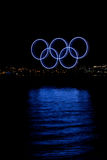 Olympic rings and lit up Canada Place, Vancouver, BC. Blue olympic rings reflected in the water during the 2010 Winter Olympic Games, Vancouver, Canada Stock Images