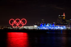 Olympic rings and lit up Canada Place, Vancouver, BC. Red glowing Olympic rings and lit up Canada Place along the waterfront during the 2010 Winter Olympic Games Stock Photography