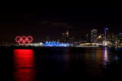 Olympic rings and lit up Canada Place, Vancouver, BC. Red glowing Olympic rings, Canada Place and media center along the waterfront during the 2010 Winter Royalty Free Stock Images