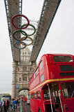 Olympic rings on London Bridge. The Olympic rings on London Bridge in London, and a red double decker bus on the right down corner Royalty Free Stock Photo