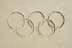 Olympic Rings Message Drawn in Sand. RIO DE JANEIRO, BRAZIL - MARCH 20, 2015: Olympic rings drawn in the sand on Ipanema Beach in anticipation of the city Royalty Free Stock Photography