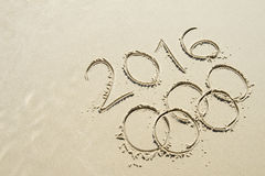 Olympic Rings 2016 Message Drawn in Sand Royalty Free Stock Photos