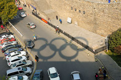 Olympic Rings shadow Nanjing China. An shadow of the five Olympic rings on the streets outside near the Nanjing city wall Jiefeng Gate in Jiangsu province China Stock Photo