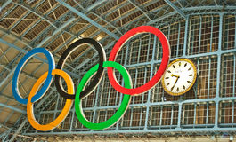 Olympic rings at St Pancras station. Olympic rings and clock at St Pancras station.London, UK,2012 Stock Photo